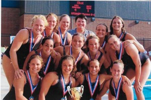 """This is a pic of our team that won Senior Nationals in 2003.  Amy Gardner and I are holding the trophy in the front."""